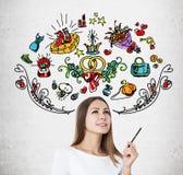 Vrouw met pen en kleurrijke huwelijkspictogrammen Stock Afbeelding