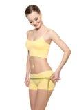 Vrouw met perfect lichaam dat billen meet royalty-vrije stock fotografie