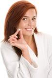 Vrouw met pil Stock Foto's