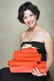 Vrouw met rode dozen Stock Foto's