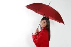 Vrouw met rode paraplu. Stock Afbeeldingen