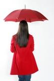 Vrouw met rode paraplu. Stock Afbeelding