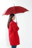 Vrouw met rode paraplu. Royalty-vrije Stock Foto's