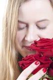 Vrouw met rode roses.GN Stock Afbeelding