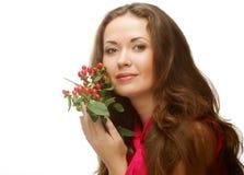 Vrouw met roze bloemen Stock Foto's