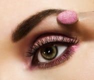 Vrouw met roze make-up stock foto