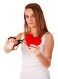 Vrouw met schaar en rood hart Stock Foto