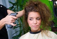 Vrouw met slordig haar Stock Afbeelding