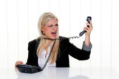 Vrouw met spanning in het bureau Stock Fotografie