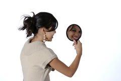 Vrouw met spiegel Stock Afbeeldingen