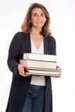 Vrouw met stapel van boeken Stock Fotografie