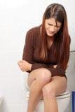 Vrouw met stomachekwesties Royalty-vrije Stock Foto