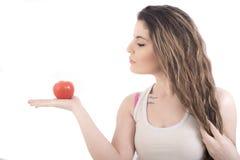 Vrouw met tomaat Royalty-vrije Stock Afbeeldingen