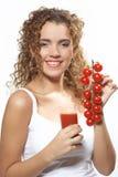 Vrouw met tomatesap. Foto N3 Stock Fotografie