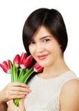 Vrouw met tulpen Stock Afbeeldingen