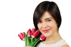Vrouw met tulpen Stock Foto