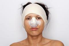 Vrouw met verbonden neus Royalty-vrije Stock Foto