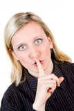 Vrouw met vinger aan lippen royalty-vrije stock afbeelding