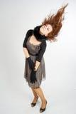 Vrouw met vliegende haren Stock Afbeeldingen