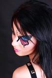Vrouw met vlindermake-up Stock Foto's