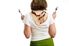Vrouw met vorken - achter stock foto's