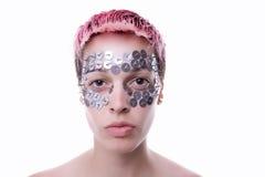 Vrouw met vreemde make-up Stock Foto's