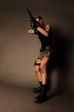 Vrouw met wapen. stock foto