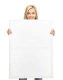 Vrouw met witte lege raad Royalty-vrije Stock Afbeelding