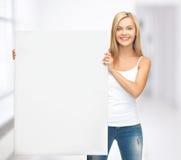 Vrouw met witte lege raad Royalty-vrije Stock Foto