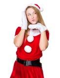 Vrouw met x-mas kostuum met grappige gezichtsuitdrukking Stock Foto