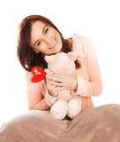 Vrouw met zacht stuk speelgoed Stock Fotografie