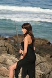 Vrouw met zwaard stock foto's