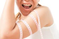 Vrouw met zwaarlijvigheid wordt geschokt die royalty-vrije stock afbeeldingen