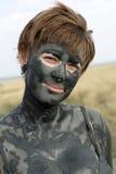 Vrouw met zwarte gezonde modder Stock Afbeeldingen
