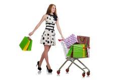 Vrouw na het winkelen in de geïsoleerde supermarkt Stock Foto's