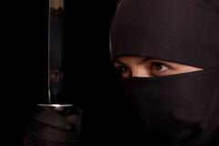 Vrouw in ninjakostuum Royalty-vrije Stock Fotografie