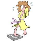 Vrouw op badkamersschaal Stock Afbeeldingen