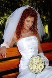 Vrouw op bank 3 Stock Fotografie
