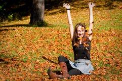 Vrouw op bladeren Royalty-vrije Stock Afbeelding
