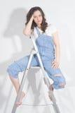 Vrouw op de ladder stock foto's