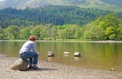Vrouw op een kust Royalty-vrije Stock Fotografie