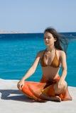 Vrouw op een strand Stock Afbeelding