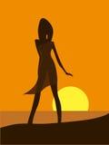 Vrouw op kust Stock Foto