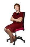 Vrouw op middelbare leeftijd als voorzitter stock afbeelding