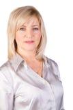 Vrouw op middelbare leeftijd in lichte blouse Stock Afbeeldingen