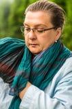 Vrouw op middelbare leeftijd met glazen het rusten stock foto's