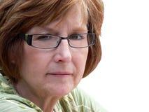Vrouw op middelbare leeftijd op witte achtergrond stock foto's