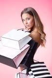 Vrouw op roze Stock Foto