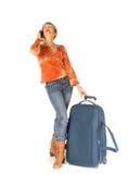 Vrouw op telefoon met koffer Stock Afbeeldingen