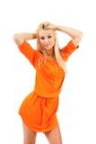 Vrouw in oranje kleding Royalty-vrije Stock Foto